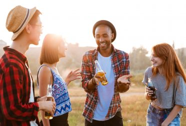 cheerful-young-people-with-beer-and-soda-talking-P9M5J6J-min